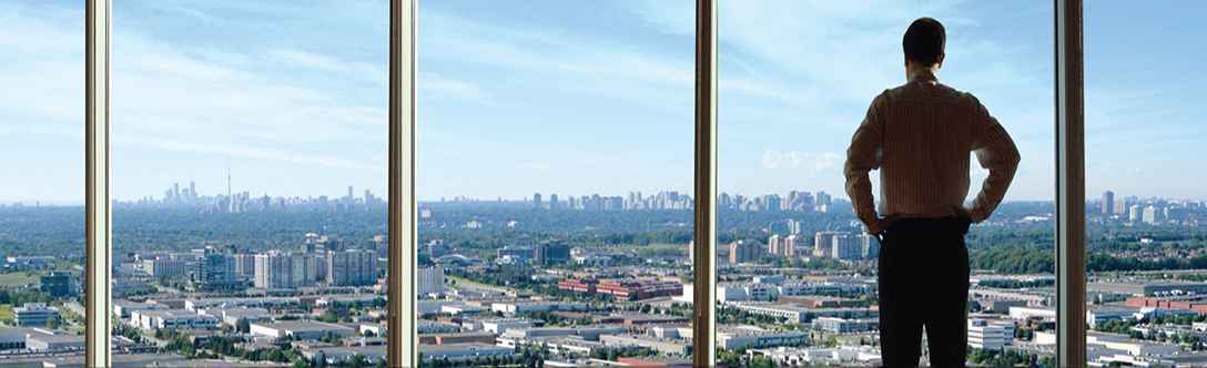 Man in Richmond Hill, looking over the City with Toronto in the background