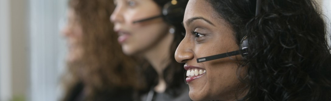 Three customer service reps on headsets