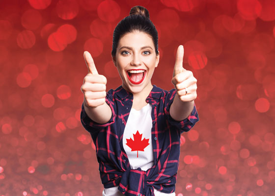 Girl in Canada shirt with thumbs p