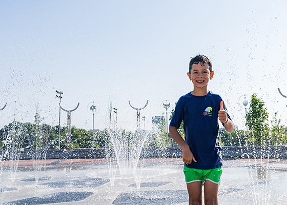 Boy giving thumbs up at Richmond Hill Splash Pad