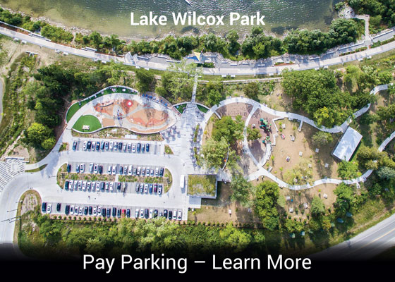 "Lake Wilcox aerial with texting saying ""Pay Parking - Learn More"""