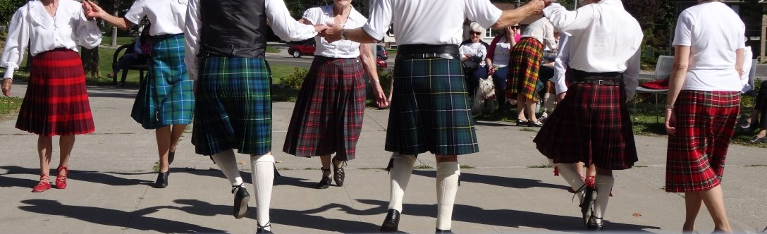 People in kilts dancing