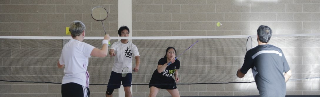 Adults playing Drop-In badminton