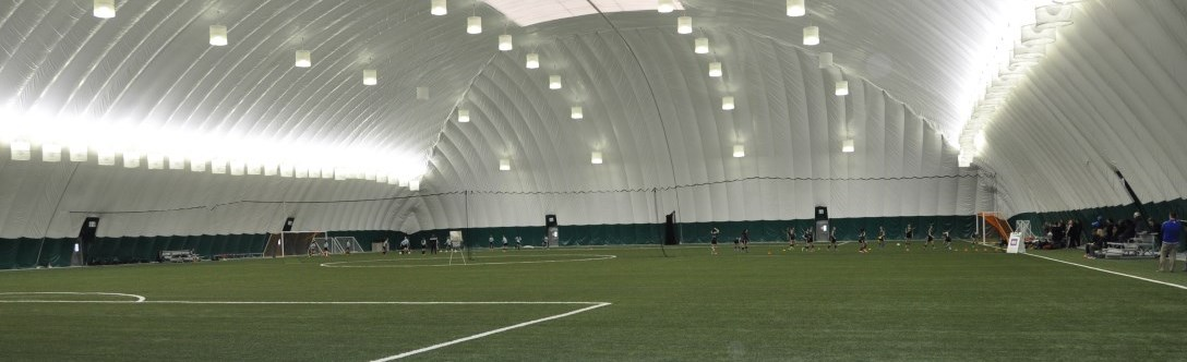 Richmond Hill sports dome with people playing soccer in the distance