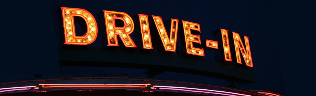 Light up sign that says Drive-in